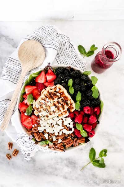 This Grilled Halloumi Berry Salad is a topped with blackberries, raspberries, strawberries, grilled halloumi, pecans, goat cheese, & a homemade lemon berry dressing.