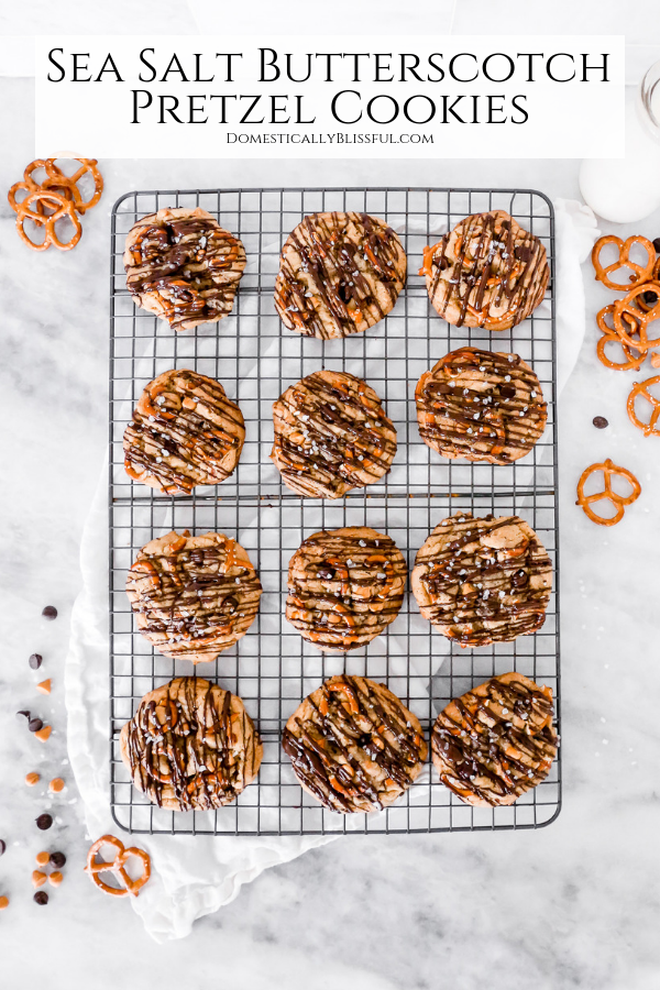These Sea Salt Butterscotch Pretzel Cookies are filled with dark chocolate, butterscotch, & pretzels & topped with a drizzle of dark chocolate & a sprinkle of sea salt.
