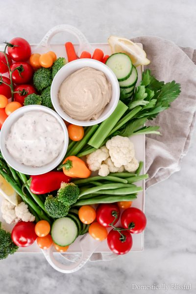 This Crudités Platter is loaded with fresh produce and is the perfect vegetable tray for weeknight meals or weekend dinner parties!
