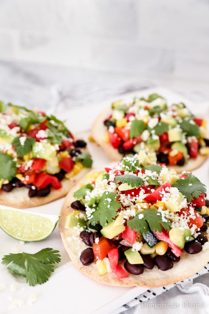 These Roasted Vegetable Tostadas are a quick & easy dinner recipe full of fresh flavor that takes less than 30 minutes to create.