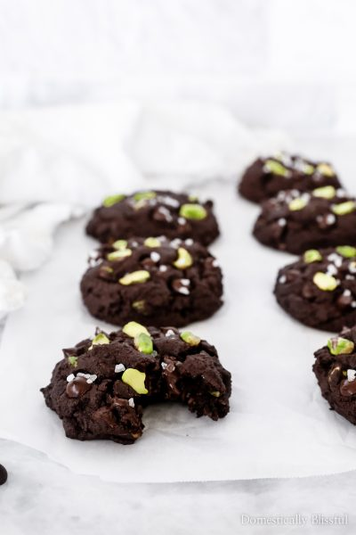 These Double Dark Chocolate Pistachio Cookies topped with sea salt and filled with dark chocolate chips and pistachios are extra-thick, soft, fluffy, and chewy.