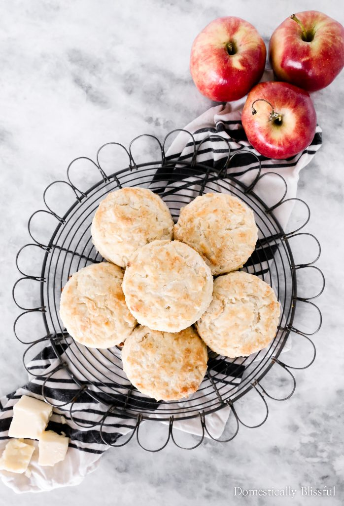 These fluffy Apple White Cheddar Biscuits are filled with flaky layers of sharp white cheddar & fresh apples making it a perfect treat for fall breakfast & brunch!
