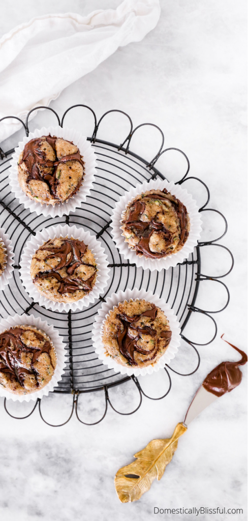 These Nutella Swirled Zucchini Muffins are the perfect early fall brunch recipe that will also make your home smell amazing.