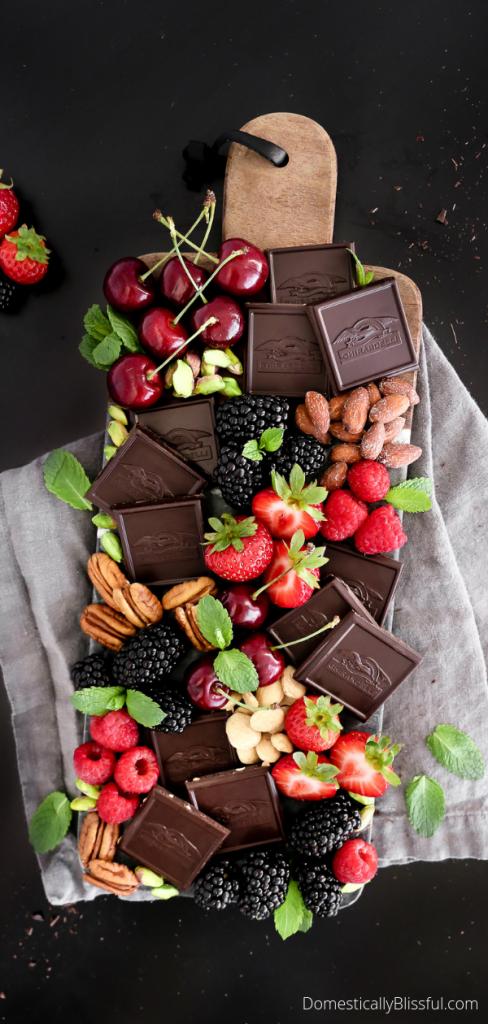 This Gourmet Chocolate Dessert Board is a decadent treat with an array of Ghirardelli Intense Dark chocolate, fresh fruits, and nuts.