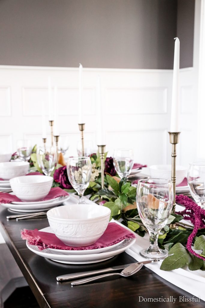 A purple pear tablescape for a fall party, Friendsgiving gathering, or Thanksgiving dinner.