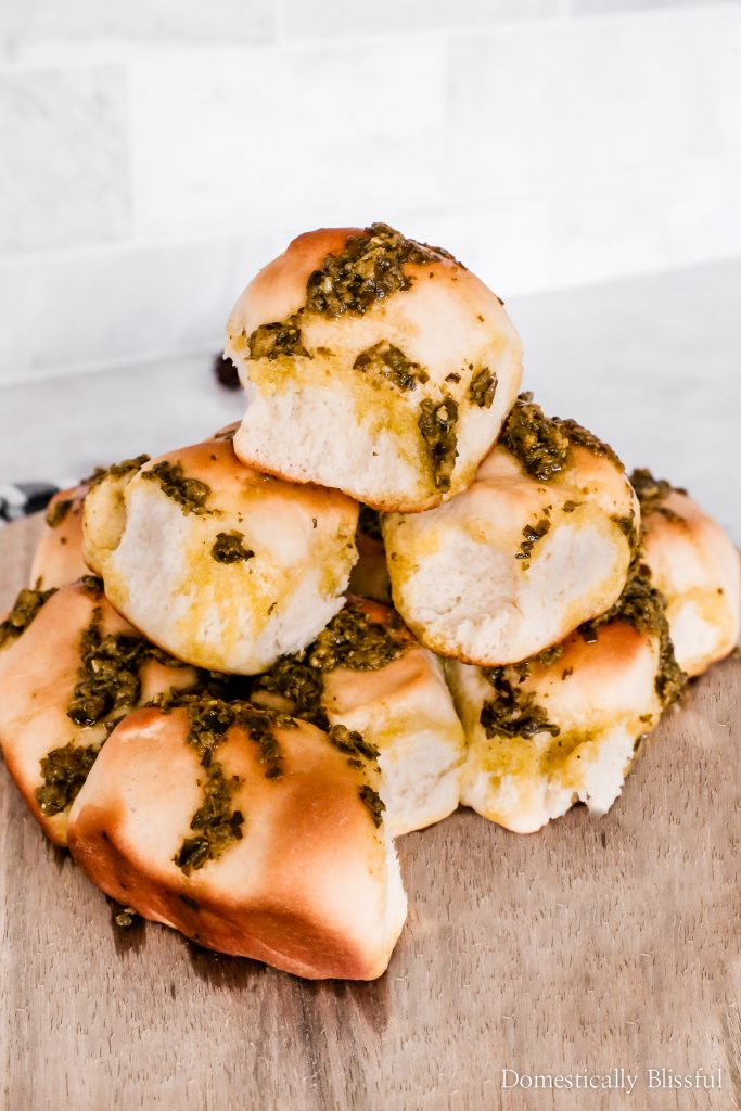 These easy Garlic Pesto Dinner Rolls are a warm and soft addition to your Italian dinner.