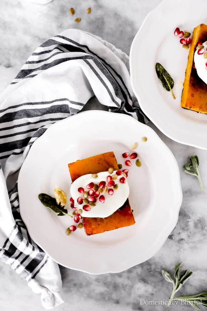 These Whipped Goat Cheese Butternut Squash Steaks are cooked in a garlic sage brown butter sauce and topped with whipped goat cheese, pumpkin seeds, and pomegranate seeds.