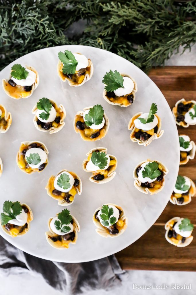 These Black Bean and Corn Taco Bites are the perfect appetizers for a party with your friends and family this holiday season!
