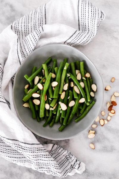 These Garlic Green Beans with sliced almonds are a family recipe that is easy to make in under 15 minutes and with only 5 ingredients.