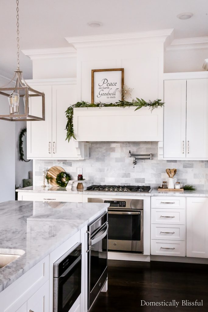 A neutral kitchen Christmas decor tour sharing all of my favorite finds and holiday decoration DIYs in our white kitchen.