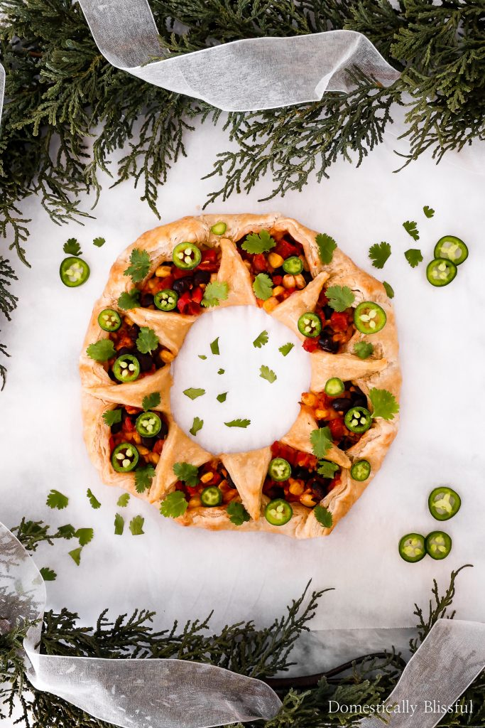 This Black Bean Enchilada Puff Pastry Wreath is the perfect savory holiday appetizer recipe for your next holiday party!