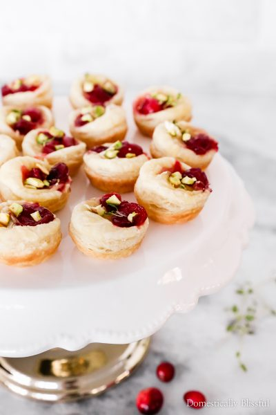 These Cranberry Brie Puff Pastry Bites are an easy appetizer recipe for a holiday party!