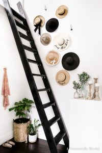This DIY Hat Wall Display is easy to create and a great way to decorate a blank wall with all of your favorite hats!
