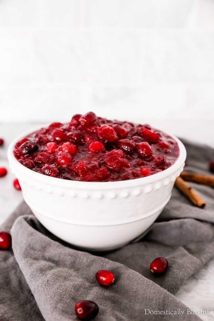 This homemade Cranberry Sauce only takes 5 ingredients and 15 minutes to make!