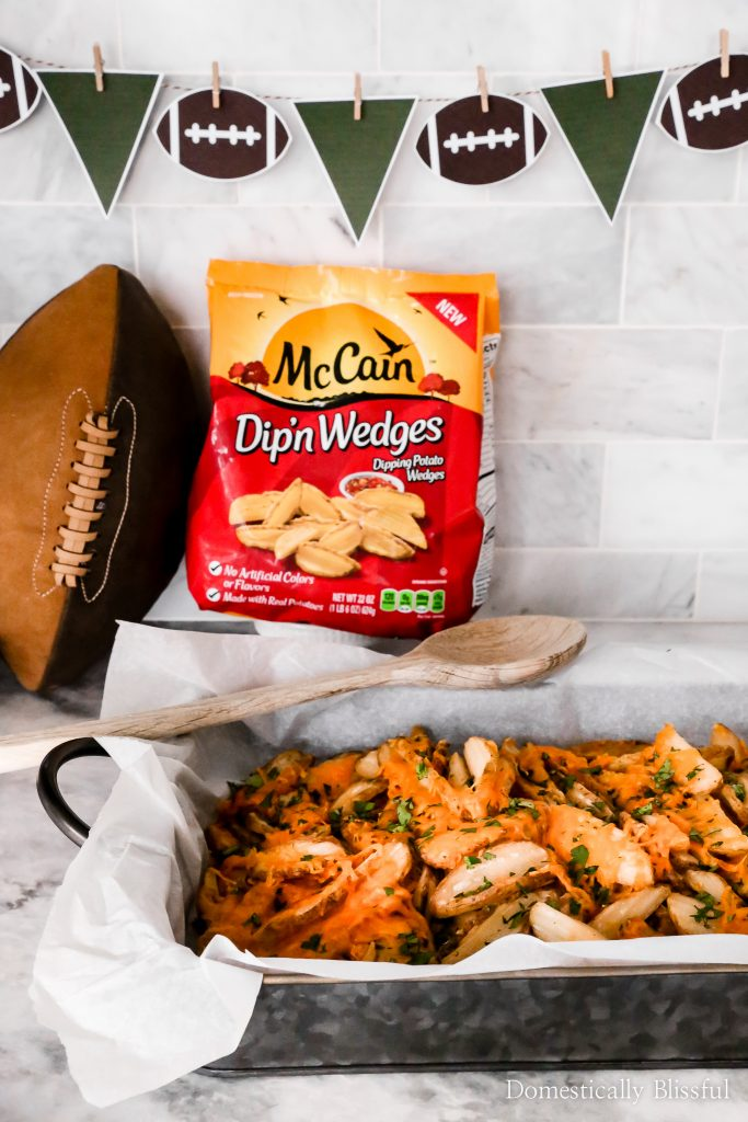This game day food bar is easy to create and is a fun way for your guests to create their own loaded potato wedges.