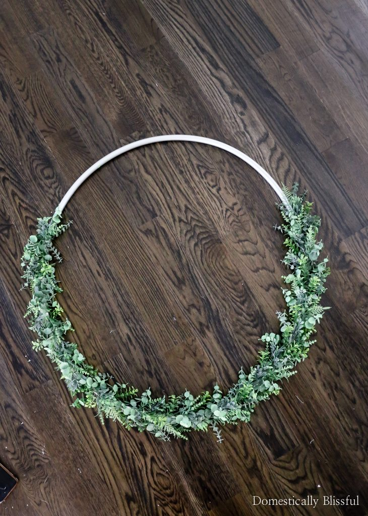 This Succulent Hoop Wreath is easy to create using a hula hoop a variety of faux eucalyptus, boxwood, and succulent stems. Plus tips on how to help the hoop keep its shape!