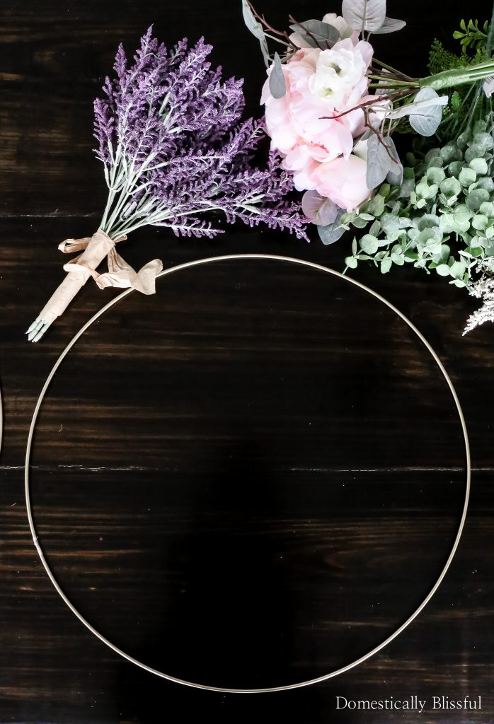 DIY Summer Wreaths for your front porch made with gold hoops, faux boxwood stems, eucalyptus, and summer flowers