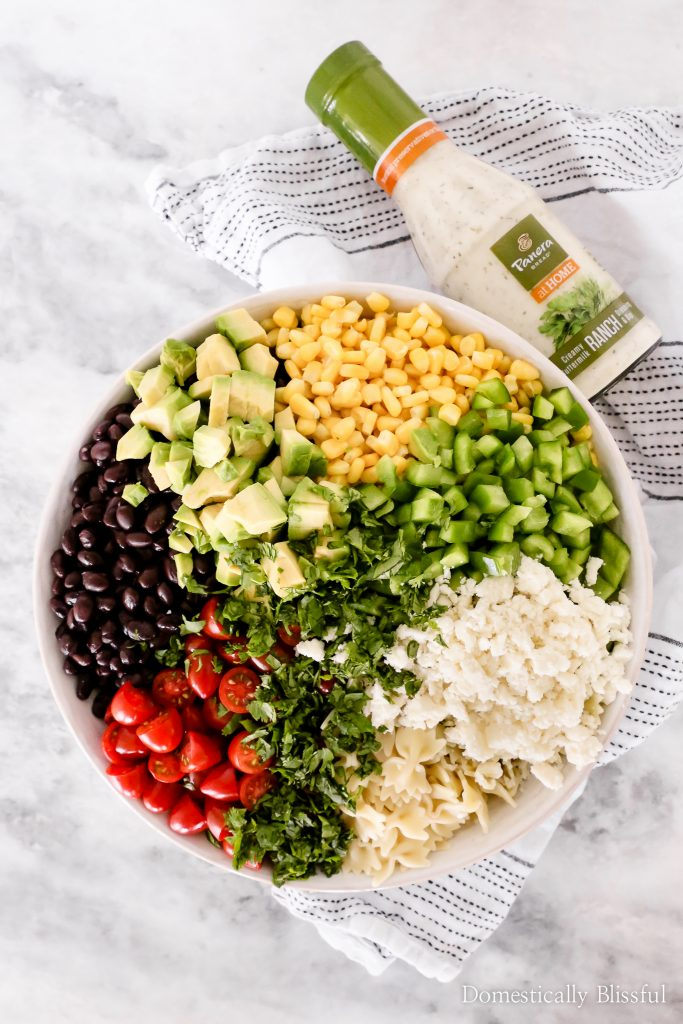 This Mexican Pasta Salad is a colorful vegetarian pasta recipe filled with fresh vegetables and topped with Panera Creamy Buttermilk Ranch+Dip at Publix.