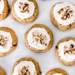 These Maple Pecan Cookies are a chewy maple cookie filled with chopped pecans and topped with a maple cream cheese frosting.