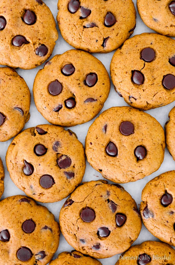 These are the Best Pumpkin Spice Chocolate Chip Cookies as they are both soft and chewy pumpkin cookies that are filled with dark chocolate chips. Plus 4 secret tips to avoid soft cakey cookies while baking pumpkin spice cookies that have a soft chewy texture.