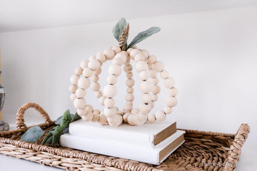 DIY Wood Bead Pumpkin tutorial for cute neutral fall pumpkin decor in your home.