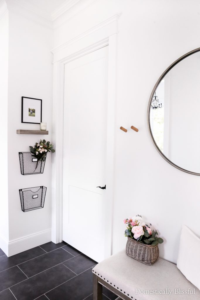 A mini-tour of our side entryway sharing all of the decor details in our mudroom reveal.