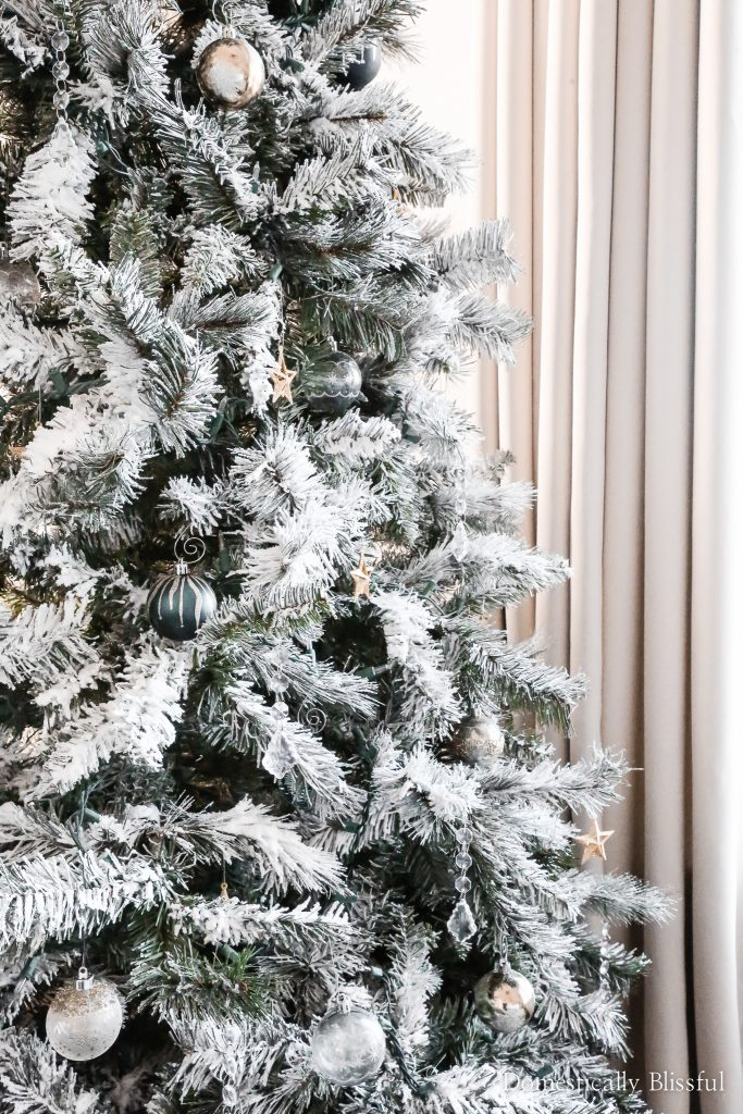 How to flock an artificial Christmas tree and turn a cheap Christmas tree into a beautiful snowy Christmas tree for your home.