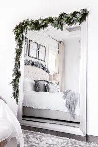 This DIY Mirror Christmas Garland is easy to create and a great way to add Christmas cheer to an oversized floor mirror!