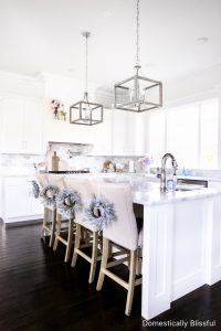 Simple Spring Kitchen Decor to refresh your white kitchen for spring with beautiful faux flowers and spring colors.