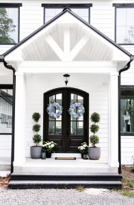 Simple summer front porch decor with live hydrangea plants and faux hydrangea wreaths.