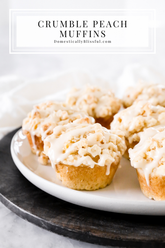 These Crumble Peach Muffins are filled with fresh peaches and topped with a sweet streusel crumble topping and a drizzle of icing.