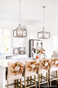 A tour of our Fall Kitchen Decor with a free fall printable, hints of orange, and faux fall flowers.